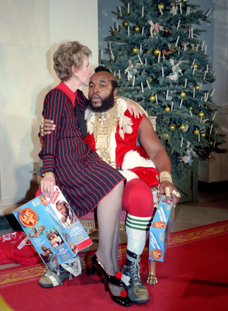 Image: Nancy Reagan sits on Mr. T's lap as he plays Santa Claus at the White House