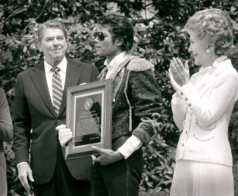 """Image: Michael Jackson holds his Presidential Award for lending his hit song \""""Beat It\"""" to a new campaign against drunk driving"""