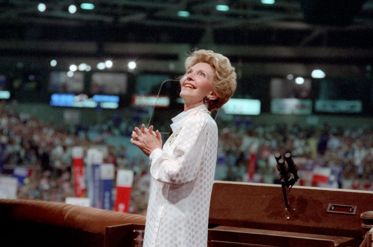 Image: Nancy Reagan looks up at an image of President Ronald Reagan