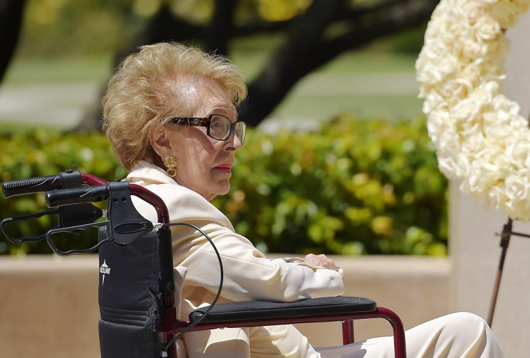 Image: Former first lady Nancy Reagan visits the grave site of her husband