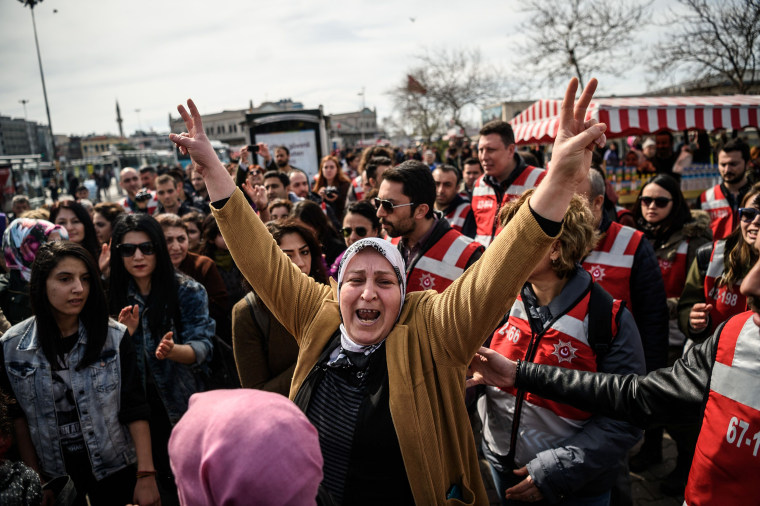 Image: A Turkish woman gives a V sign during a march