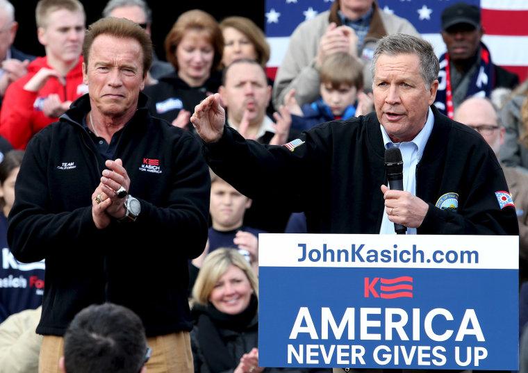 Image: Ohio Governor and Republican U.S. presidential candidate John Kasich speaks at a rally as former California Governor Arnold Schwarzenegger looks on in Columbus