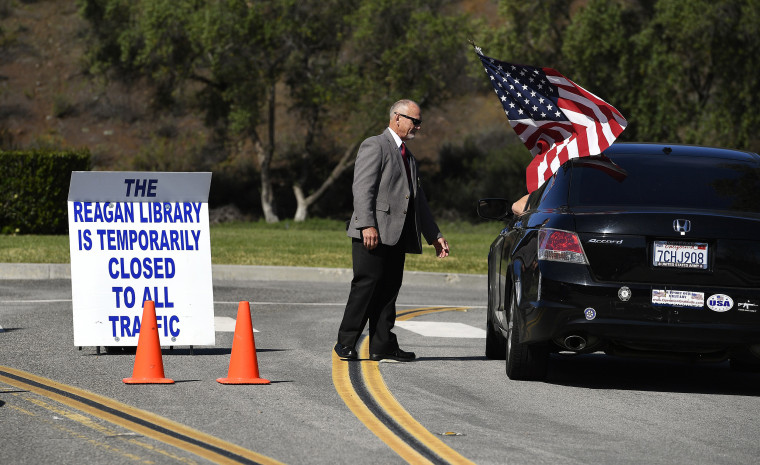 Image: Security guard Doug Wiley tells Andy Hall that the Ronald Reagan Presidential Library is closed