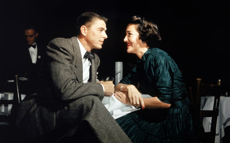 Image: American actor Ronald Reagan and his wife Nancy Reagan gaze at one another across a table
