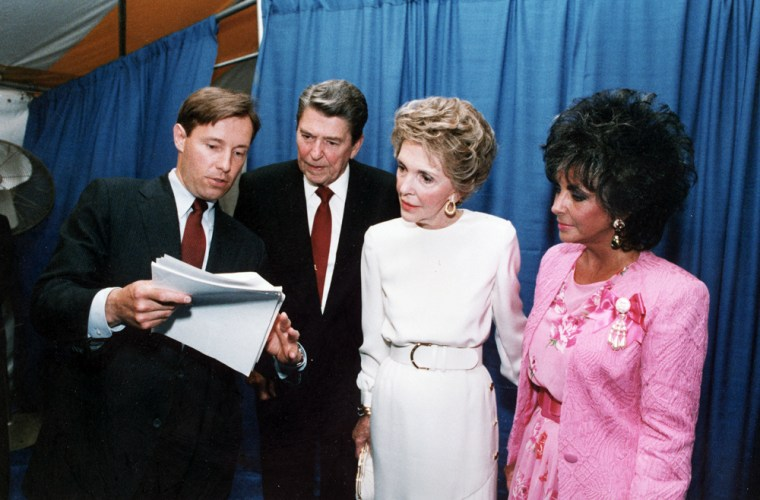 Image: President Ronald Reagan and First Lady Nancy Reagan look at notes