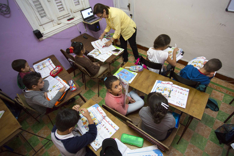 Students attend an English class at the Cuban School of Foreign Languages, in Havana, Cuba.