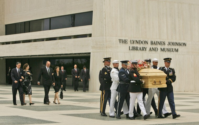 Image: Armed services body bearers remove the casket of Lady Bird Johnson