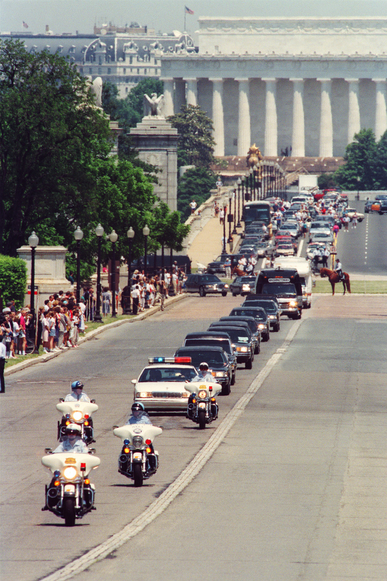 Image: The funeral procession of Jacqueline Kennedy Onassis stretches out in front of the Lincoln Memorial