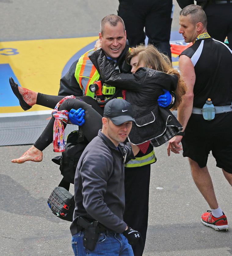Image: A Boston firefighter carries Victoria McGrath