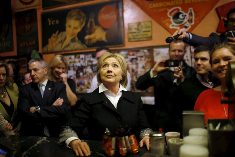 Image: U.S. Democratic presidential candidate Hillary Clinton looks at the menu during a campaign stop at Yesterdog restaurant in Grand Rapids, Michigan,