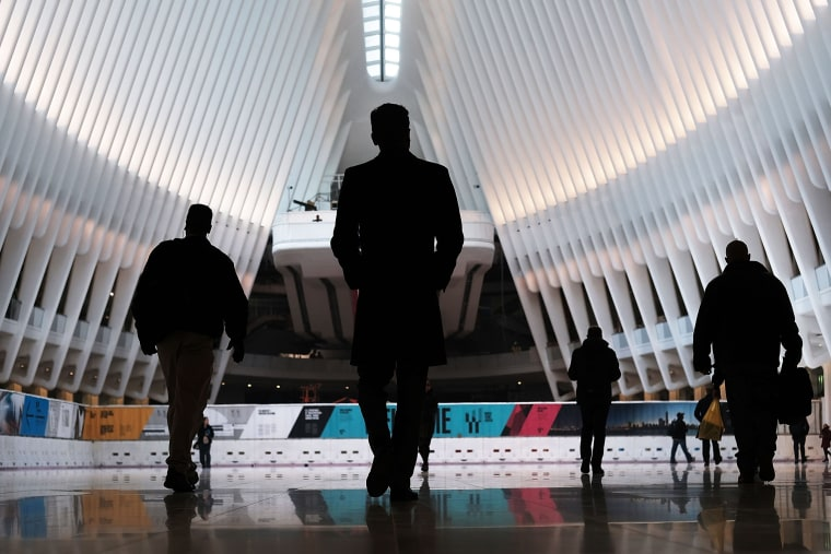 Image: Commuters walk through the Oculus of the partially opened World Trade Center Transportation Hub