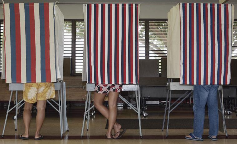 Image: Voters cast their ballots at Mililani Waena Elementary school Saturday, Sept. 23, 2006, in Mililani, Hawaii.
