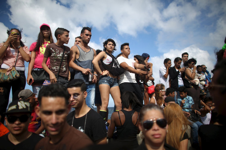 Image: People at the seafront Malecon watch a performance by U.S. electronic music group Major Lazer in Havana