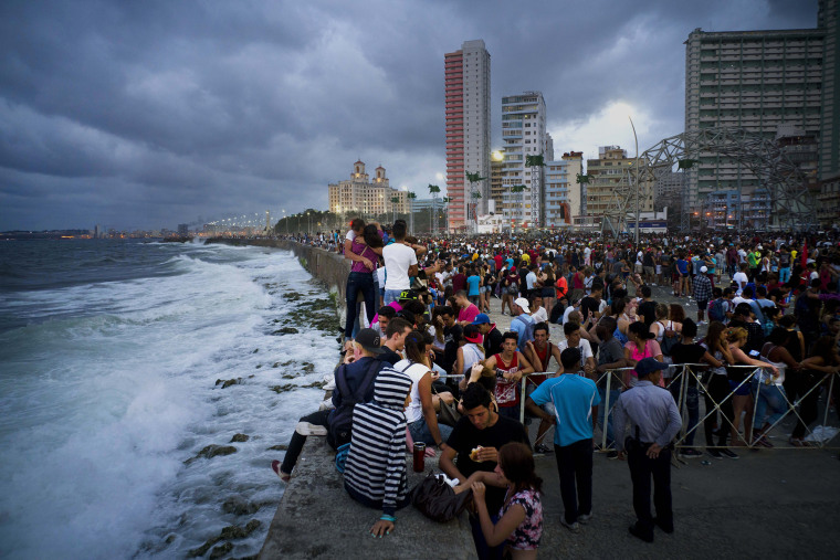 Image: Fans enjoy the afternoon at the Havana seafront after a free concert in Havana