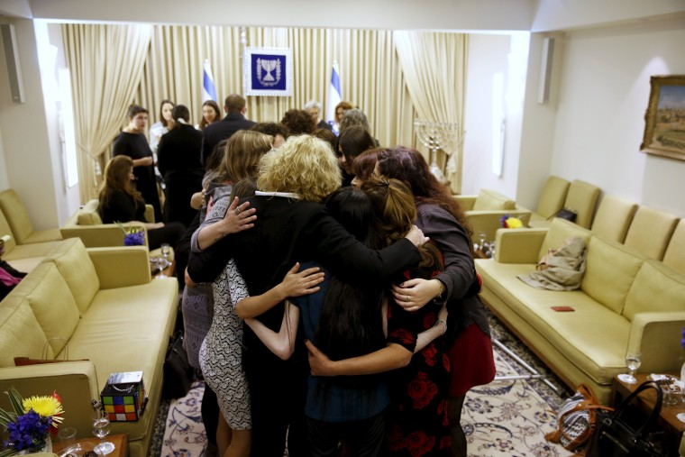 Image: Women who took part in a project ahead of International Women's Day, hug during a meeting with Nechama Rivlin, wife of Israeli President Rivlin in Jerusalem