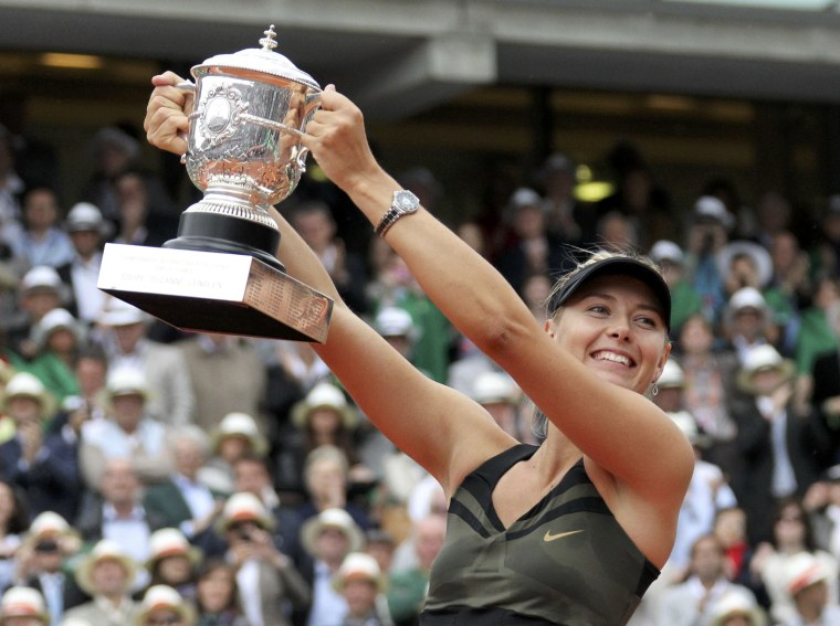 Image: Sharapova of Russia holds the trophy as she poses during the ceremony after defeating Errani of Italy during their women's singles final match at the French Open tennis tournament at the Roland Garros stadium in Paris
