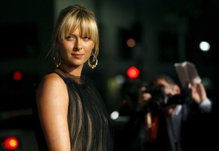Image: File photo of Maria Sharapova posing at a premiere in Hollywood