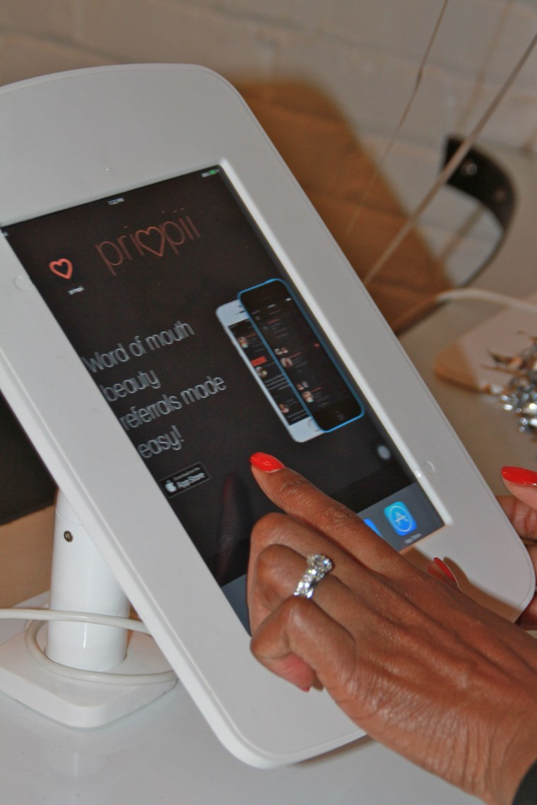 An iPad display of the beauty-sharing app, Primpii - founded by Tausha Robertson.