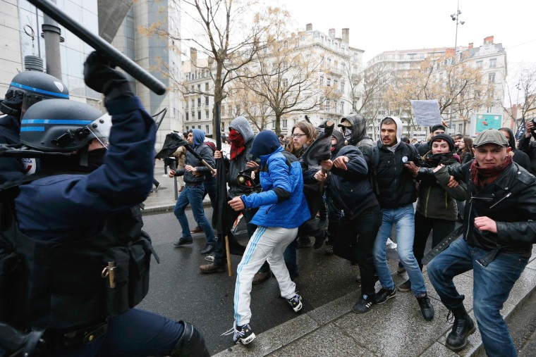 Image: Students and workers face off with French police during a demonstration against the French labour law proposal in Lyon, France, as part of a nationwide labor reform protest