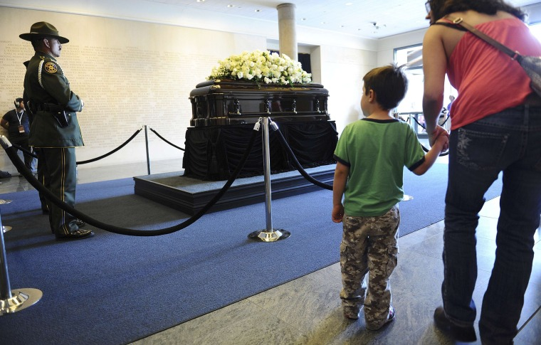 Image: People come to pay their respects in front of the casket of former first lady Nancy Reagan as she lies in repose at the Reagan Presidential Library in Simi Valley California