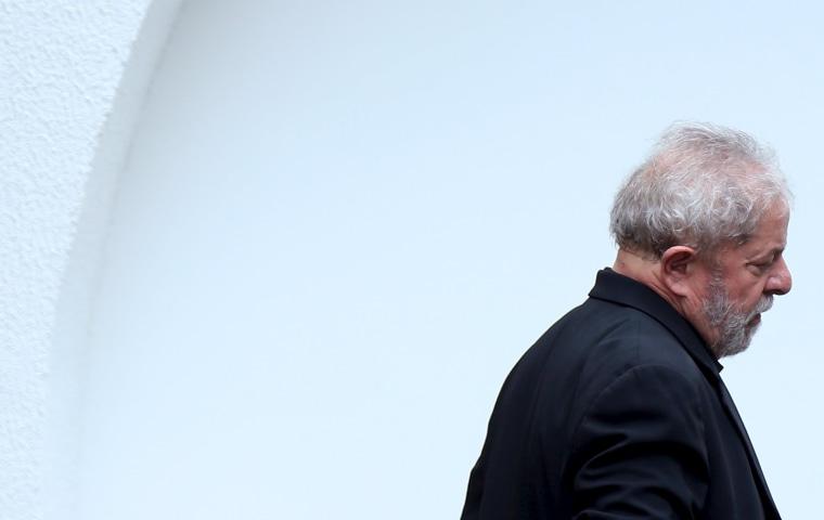 Image: Brazil's former President Luiz Inacio Lula da Silva leaves a meeting with senators of the Brazilian Democratic Movement Party (PMDB) in Brasilia