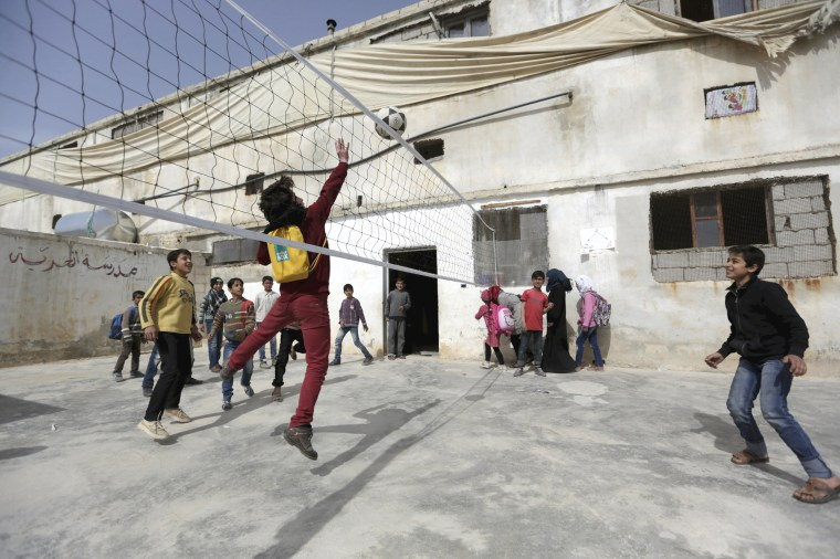 Image: Students play during their break at the Freedom School, in the town of al-Tamanah, in the southern countryside of Idlib