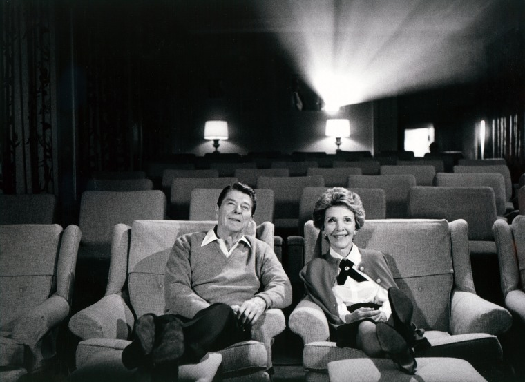 The Reagans sit in a cozy 44 seat screening room at the White House.