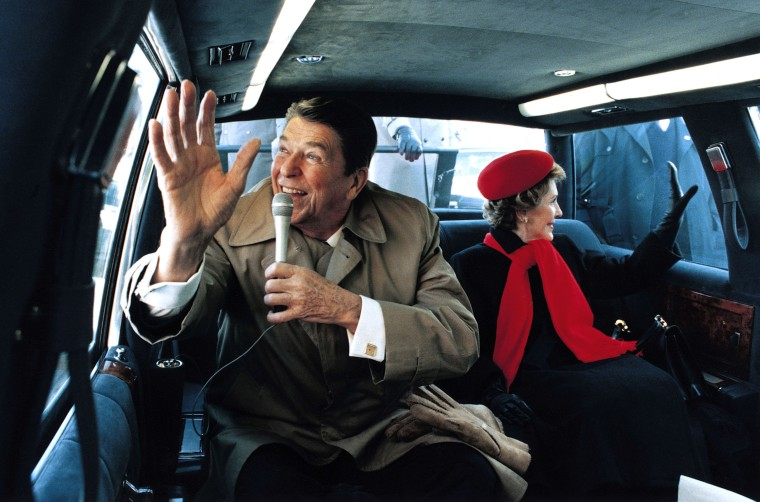 The Reagans wave to well-wishers in his hometown of Dixon, Illinois in February 1984.