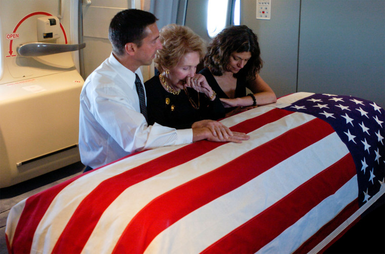 Nancy Reagan and her son Ron and his wife Doria at Ronald's coffin.
