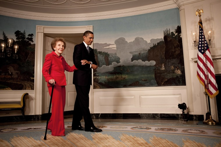 President Barack Obama escorts former First Lady Nancy Reagan in the Diplomatic Room of the White House on June 2, 2009.