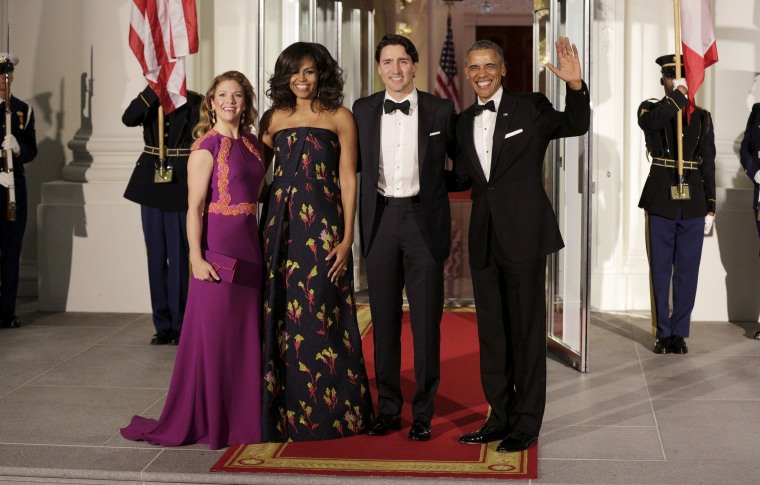 Image: U.S. President Barack Obama and first lady Michelle Obama welcome Canada's Prime Minister Justin Trudeau and his wife Sophie Gregoire-Trudeau as they arrive for a state dinner at the White House in Washington