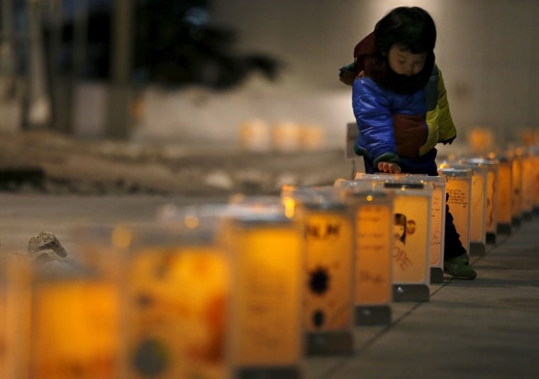 Image: Lanterns from the northern Japanese city of Natori are illuminated during an event
