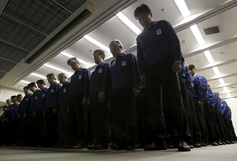 Image: Employees of Tokyo Electric Power Co. (TEPCO), observe a moment of silence
