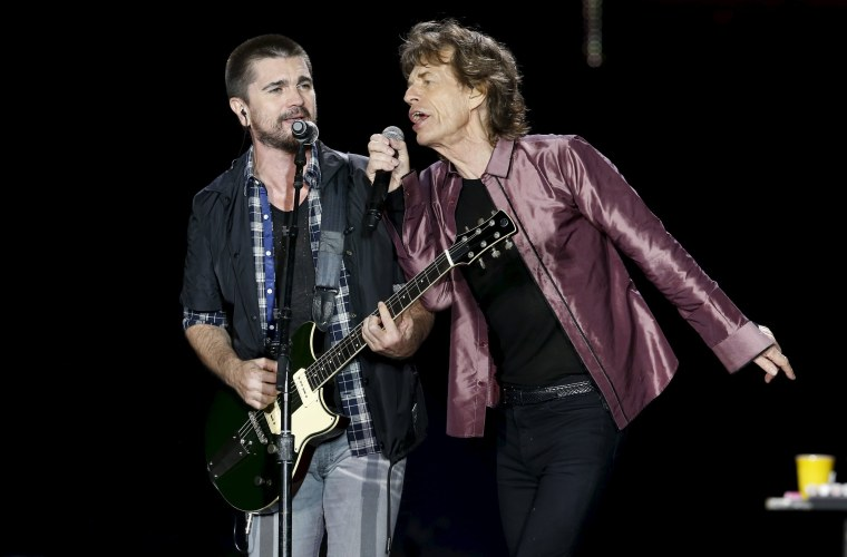 "Image: Mick Jagger of The Rolling Stones sings with Colombian singer Juanes during their ""Latin America Ole Tour"" in Bogota"