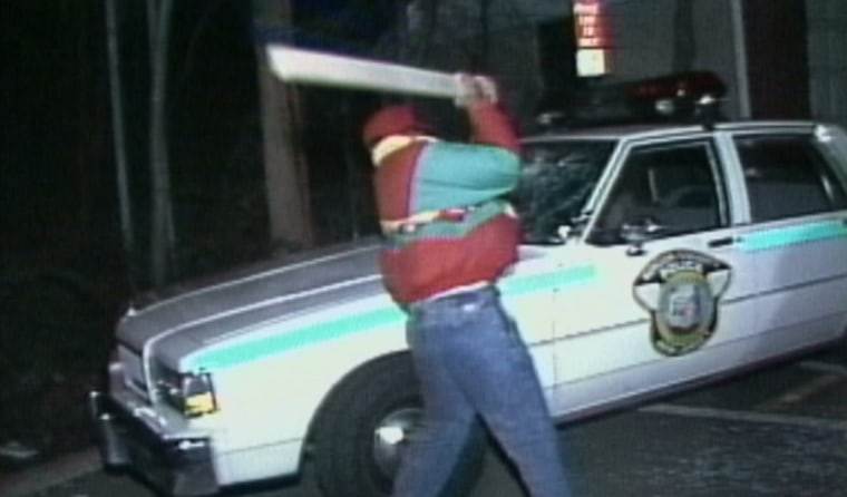 Image: A protester smashes a Teaneck Police car during protests in 1990