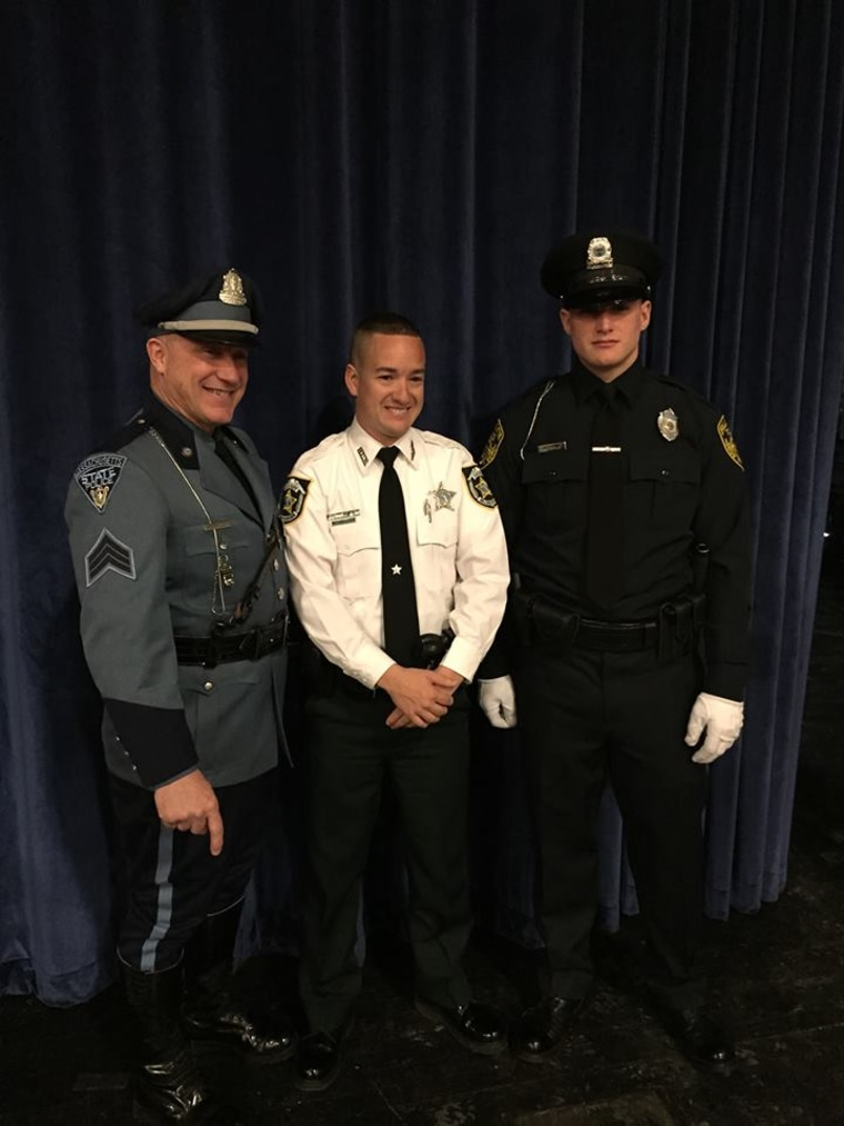 Deputy John Kotfila Jr. with his father Sergeant John Kotfila Sr. with the Massachusetts State Police and his brother Officer Michael Kotfila of the Plymouth Police Department.