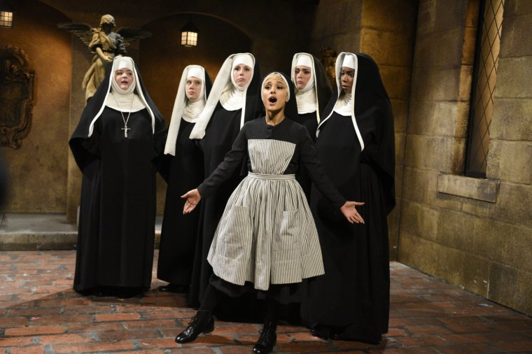 Image: Ariana Grande performs a sketch as she hosts Saturday Night Live