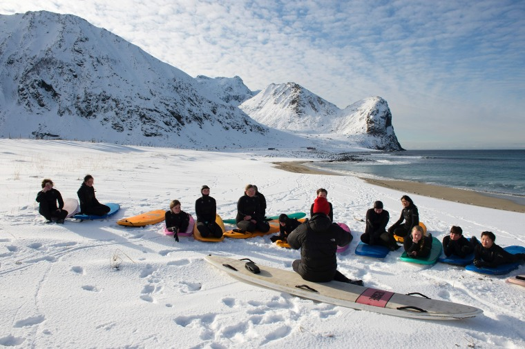 Image: A group of beginner surfers from Norway attend their sit on Unstad's snowy beach