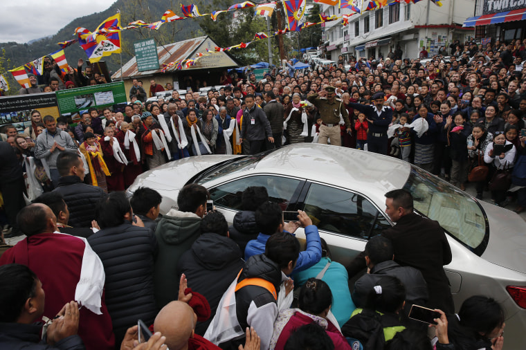 Image: Exile Tibetans welcome their spiritual leader the Dalai Lama as he arrives in Dharamsala