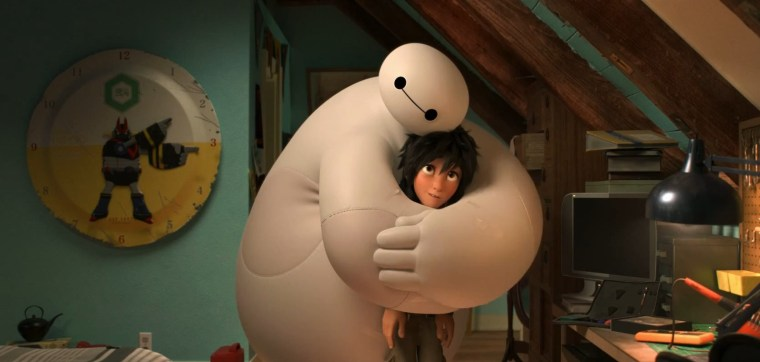 "Still from the trailer for ""Big Hero 6,"" showing the soft robot Baymax hugging the protagonist, Hiro."