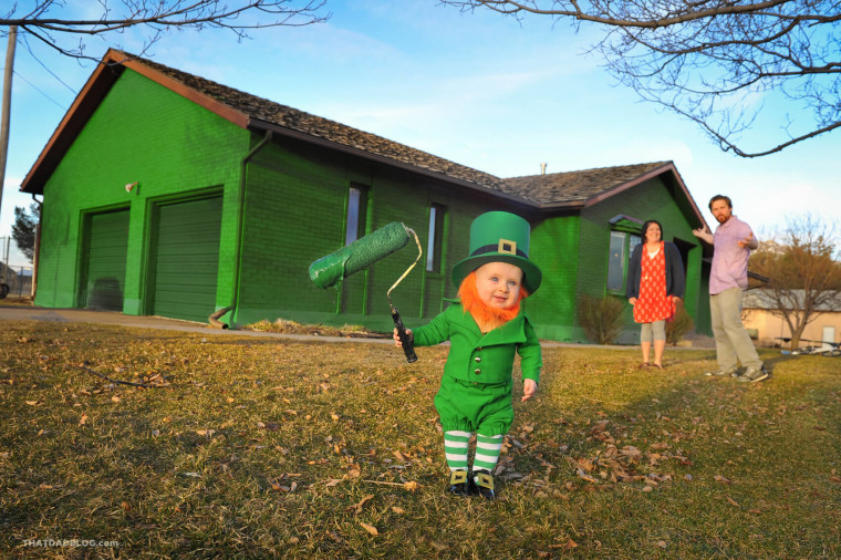 Baby Rockwell has some fun with green paint.