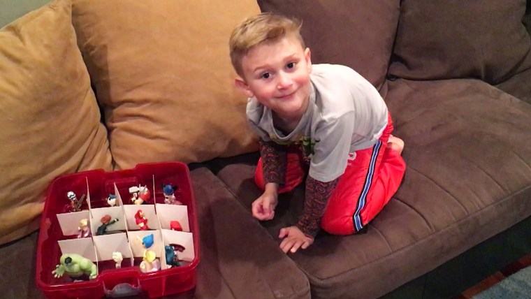 TODAY Parenting Team member Amanda Mushro keeps her son's toys organized with a Christmas ornament box.