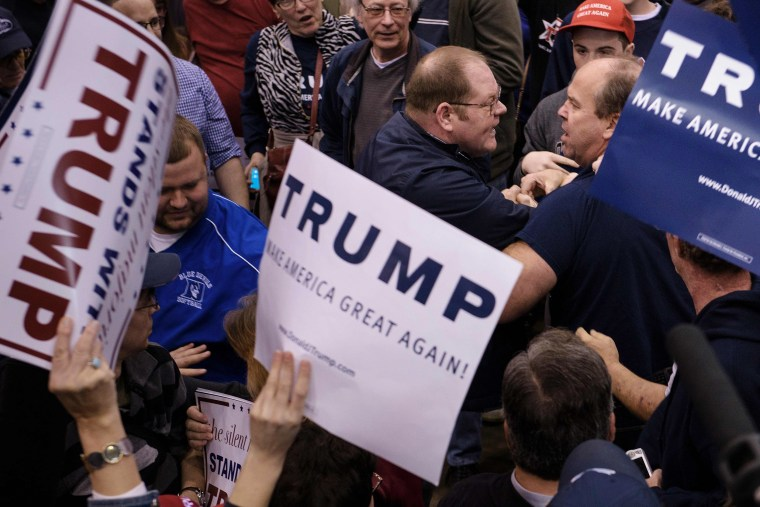 Image: Attendees clash during a Trump rally