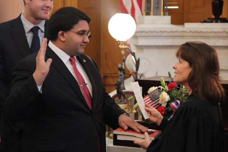 Niraj Antani, the first Indian American elected to Ohio's state legislature and a practicing Hindu, being sworn in.
