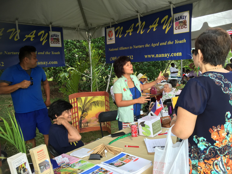 A voter registration and education booth hosted by NANAY at a cultural event.