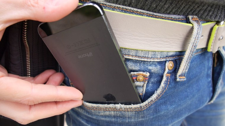 Image: A cellphone is placed in a pocket