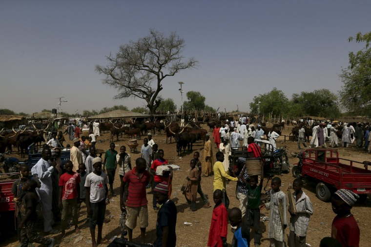 Image: People gather at the cattle market