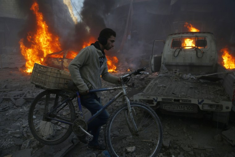 Image: The aftermath of airstrikes in Hamouria, Syria, on Dec. 9, 2015
