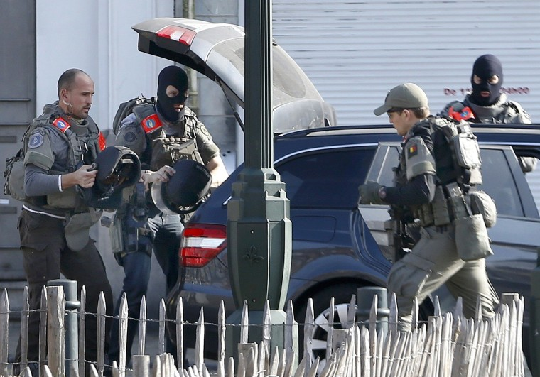 Image: Police at the scene where shots were fired during a police search of a house in the suburb of Forest near Brussels, Belgium, March 15, 2016.