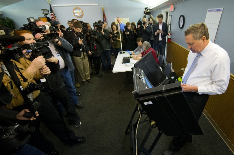 Image: Kasich casts his ballot in the primary election